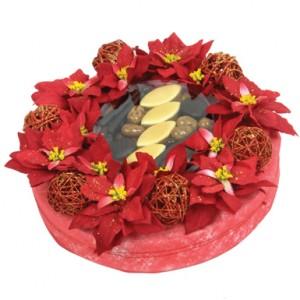 idée de cadeau de noel avec un bouquet de fleurs et chocolats